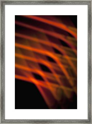 Abstract Pattern Of Crisscrossing Orange And Red Light Beams Framed Print by Halfdark