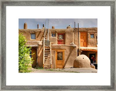 Adobe Homes Framed Print by Stellina Giannitsi