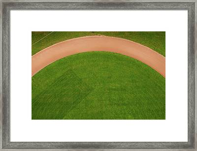 Aerial View Of Running Track Framed Print by Ivo Noppen