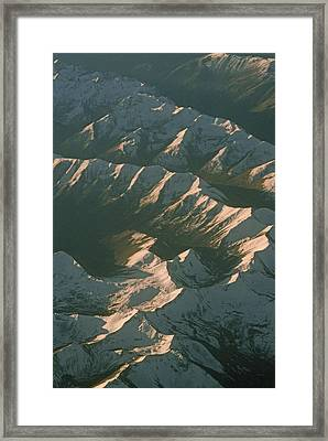 Aerial View Of Snowcapped Mountain Framed Print by Gordon Wiltsie