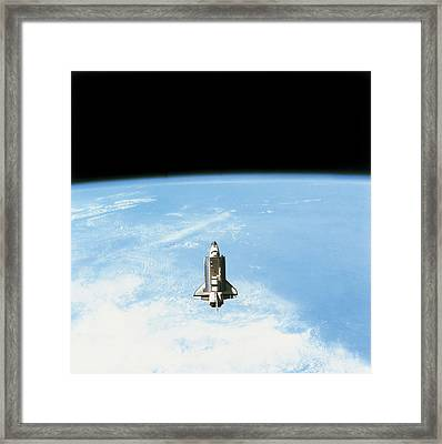 Aerial View Of The Space Shuttle In Orbit Above Earth Framed Print by Stockbyte
