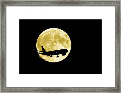 Aeroplane Silhouetted Against A Full Moon Framed Print by David Nunuk