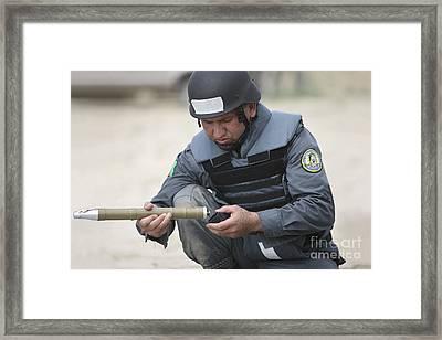 Afghan Police Student Prepares Framed Print by Terry Moore