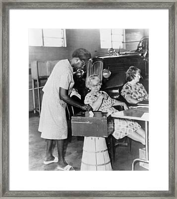 African-american Woman Placing Ballot Framed Print by Everett