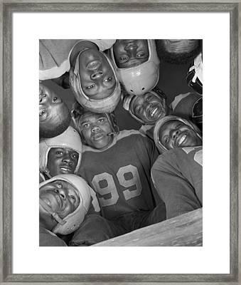 Africans American Football Huddle Framed Print by Everett