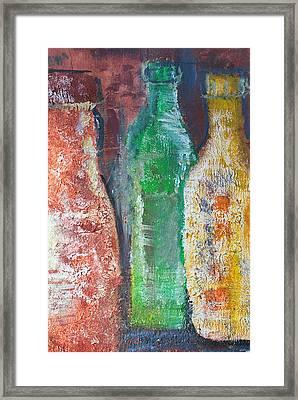 Aged Bottles Framed Print by Janice Gelona