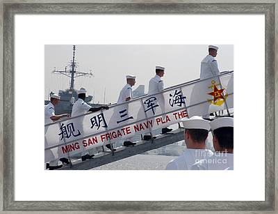 Ailors Board The Peoples Liberation Framed Print by Stocktrek Images