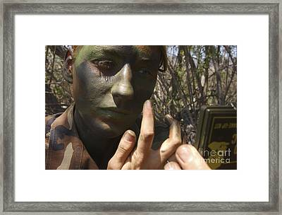 Airman Applies Camouflage Paint Framed Print by Stocktrek Images