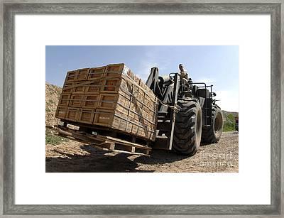 Airman Loads A Pallet Of Ammunition Framed Print by Stocktrek Images