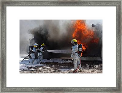 Airman Looks On As Fellow Firefighters Framed Print