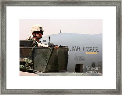 Airman Mans The Turret Atop A Humvee Framed Print by Stocktrek Images