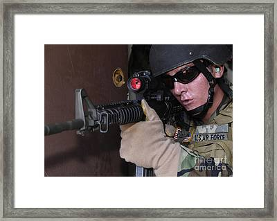 Airman Posts Security At The Front Door Framed Print by Stocktrek Images
