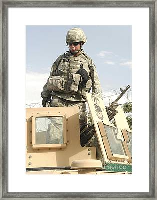 Airman Prepares For A Patrol And To Man Framed Print