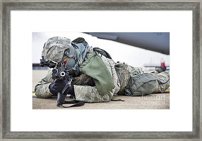 Airman Provides Security At Whiteman Framed Print