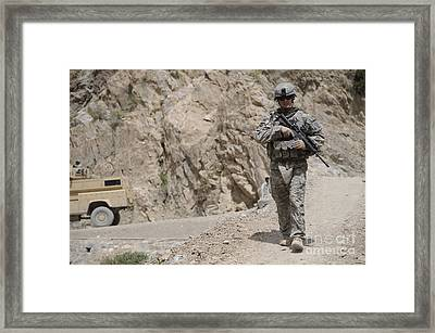 Airman Provides Security During Combat Framed Print by Stocktrek Images