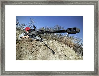 Airman Sights A .50 Caliber Sniper Framed Print by Stocktrek Images
