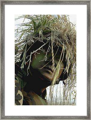 Airman Wearing A Ghillie Suit Framed Print by Stocktrek Images