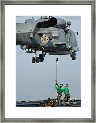 Airmen Assist Each Other As They Hook Framed Print