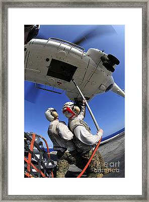 Airmen Attach Pallet Rigs To An Sa-330j Framed Print by Stocktrek Images