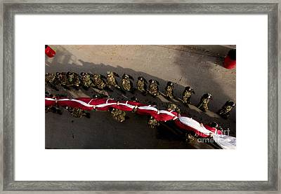 Airmen Carrying A 100-yard-by-50-yard Framed Print by Stocktrek Images