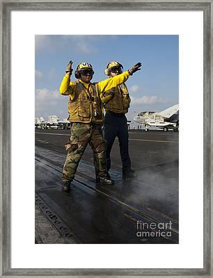 Airmen Direct An Fa-18c Hornet Framed Print by Stocktrek Images