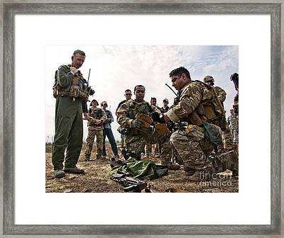 Airmen Explain Their Evidence Gathering Framed Print by Stocktrek Images