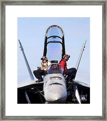 Airmen Perform A Weapons Release Check Framed Print by Stocktrek Images
