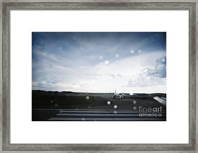 Airplane On Runway Framed Print