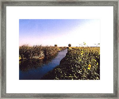Airport Canal Framed Print by Eunice Olson
