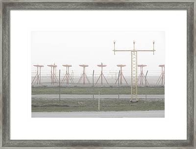 Airport Runway In Fog Framed Print by Sindre Ellingsen