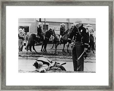 Alabama State Trooper Stands Over An Framed Print by Everett