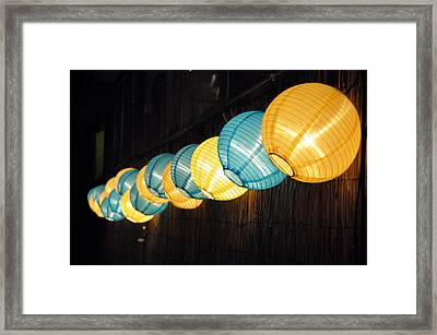 All In A Row Framed Print by Sandy Fisher
