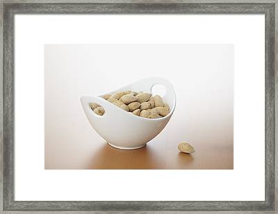 Almonds In Bowl Framed Print by Bruce Law