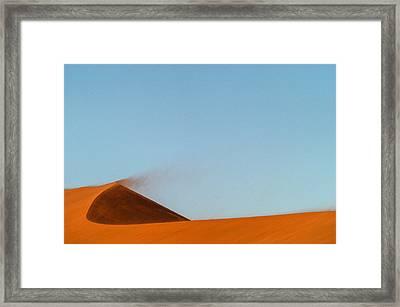 Amber Dust Framed Print