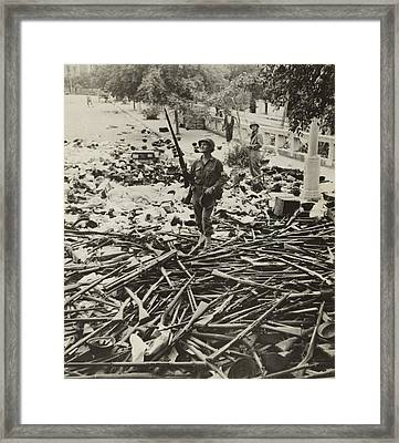 American M.p. Standing On A Large Pile Framed Print by Everett