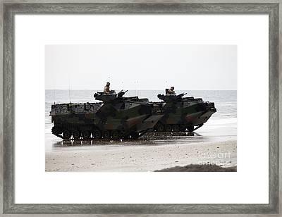 Amphibious Assault Vehicles Land Ashore Framed Print by Stocktrek Images
