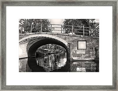 Amsterdam Canal Bridge In Sepia Framed Print by Gregory Dyer