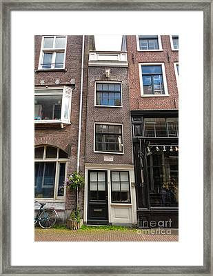 Amsterdam Skinny House Framed Print by Gregory Dyer