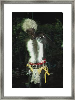 An Aboriginal Man Smears His Chest Framed Print by Sam Abell