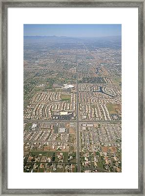 An Aerial View Of A Highly Developed Framed Print by Rich Reid
