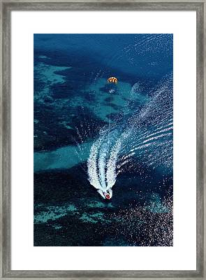 An Aerial View Of A Motorboat Towing Framed Print by Paul Chesley