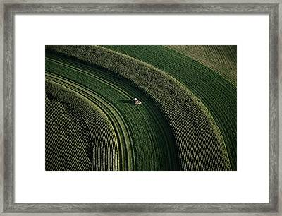 An Aerial View Of A Tractor On Curved Framed Print by Paul Chesley