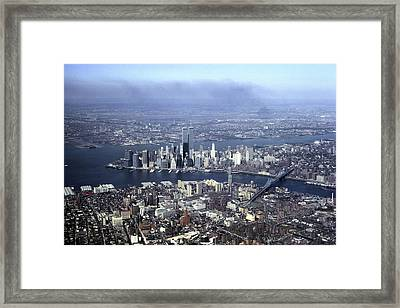 An Aerial View Of The Twin Towers Framed Print by Rex A. Stucky