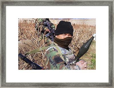 An Afghan Commando On Patrol Framed Print
