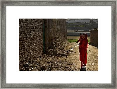 An Afghan Girl Carries Her Little Framed Print