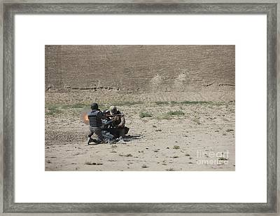 An Afghan Police Studen Fires Framed Print by Terry Moore