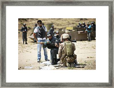 An Afghan Police Student Loads A Rpg-7 Framed Print