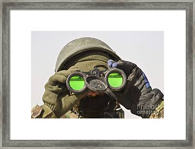 An Afghan Soldier Scans The Horizon Framed Print