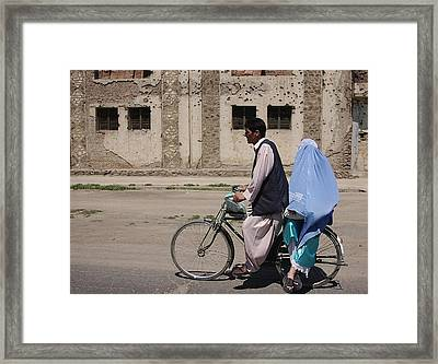 An Afghani Couple Rides A Bicycle Framed Print