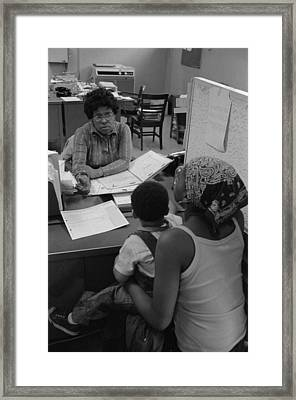 An African American Woman With A Child Framed Print
